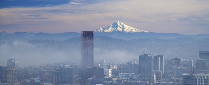 Morning fog clearing out in downtown portland with Mt Hood in the background